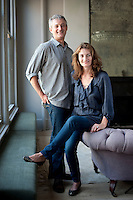 Andrew Corrie and Harriet Maxwell Macdonald sitting in the living room of their Manhattan loft