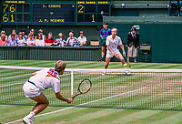 London, England, 2 th. July, 1991, Tennis,  Wimbledon, John McEnroe (USA) (background) is defeated in round  of 16 by Steffan Edberg (SWE) 76 61 64.<br /> Photo: Henk Koster/tennisimages.com