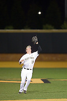 Wake Forest Demon Deacons shortstop Conor Keniry (14) settles under a fly ball in shallow left field during the game against the High Point Panthers at Wake Forest Baseball Park on April 2, 2014 in Winston-Salem, North Carolina.  The Demon Deacons defeated the Panthers 10-6.  (Brian Westerholt/Four Seam Images)