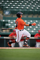 Baltimore Orioles Ian Evans (63) follows through on a swing during a Florida Instructional League game against the Philadelphia Phillies on October 4, 2018 at Ed Smith Stadium in Sarasota, Florida.  (Mike Janes/Four Seam Images)