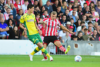 Lincoln City's Harry Anderson vies for possession with  Norwich City's Time Klosse<br /> <br /> Photographer Andrew Vaughan/CameraSport<br /> <br /> Football Pre-Season Friendly - Lincoln City v Norwich City - Tuesday 10th July 2018 - Sincil Bank - Lincoln<br /> <br /> World Copyright &copy; 2018 CameraSport. All rights reserved. 43 Linden Ave. Countesthorpe. Leicester. England. LE8 5PG - Tel: +44 (0) 116 277 4147 - admin@camerasport.com - www.camerasport.com