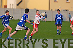 Cathal Garvey An Gealtacht (red), KOR's Kieran Brick (9) and Rory Doyle.