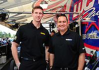 Jan. 17, 2012; Jupiter, FL, USA: NHRA top fuel dragster driver Morgan Lucas (left) and teammate Brandon Bernstein during testing at the PRO Winter Warmup at Palm Beach International Raceway. Mandatory Credit: Mark J. Rebilas-