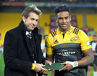 NZ Rugby's Mark Robinson presents Julian Savea with a mere commemorating his 100th Super Rugby game after the Super Rugby match between the Hurricanes and Chiefs at Westpac Stadium in Wellington, New Zealand on Friday, 9 June 2017. Photo: Dave Lintott / lintottphoto.co.nz