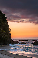 Remote, wild West Coast beach at sunset, South Westland, West Coast, New Zealand