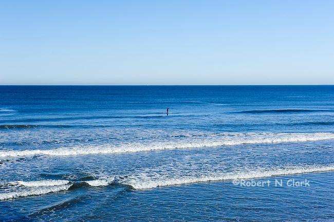Paddleboard Surfer near Oceanside Pier