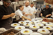 The mood in the kitchen was mostly light-hearted, with competing chefs Adam Rose of Il Palio, in black coat on the far right, and Chef Ryan Payne of Weathervane, in white coat, center, helping to plate each other's dishes.