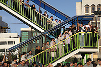 Large crowds gather in Haftetir Square in silent protest. Following a disputed election result, thousands of supporters of opposition candidate Mir-Hossein Mousavi took to the streets in protest.