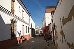 Cobbled road whitewashed buildings, Barrio de Santiago, Jerez de la Frontera, Spain