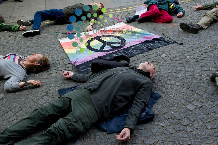 An Anti-NATO protest by the Trident Ploughshares takesplace outside the SNP HQ  in Edinburgh, 9th August, 2012..Picture:Scott Taylor Universal News And Sport (Europe) .All pictures must be credited to www.universalnewsandsport.com. (Office)0844 884 51 22.