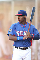 Chad Smith (7) of the AZL Rangers warms up before a game against the AZL Angels at the Texas Rangers Spring Training Complex on July 1, 2015 in Surprise, Arizona. Rangers defeated Angels, 3-1. (Larry Goren/Four Seam Images)
