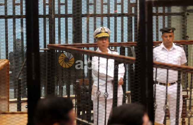 Egyptian President, Mohammad Morsi, stands behind bars as his trial on charges of espionage continues, Cairo, Egypt, 28 April 2015. Morsi has been charged along with several others of leaking classified documents while President to the Qatari intelligence services and Qatari news channel al-Jazeera, though Mrosi, detained since his overthrow by the army July 2013, denies the charges, calling them politically motivated. Photo by Stringer