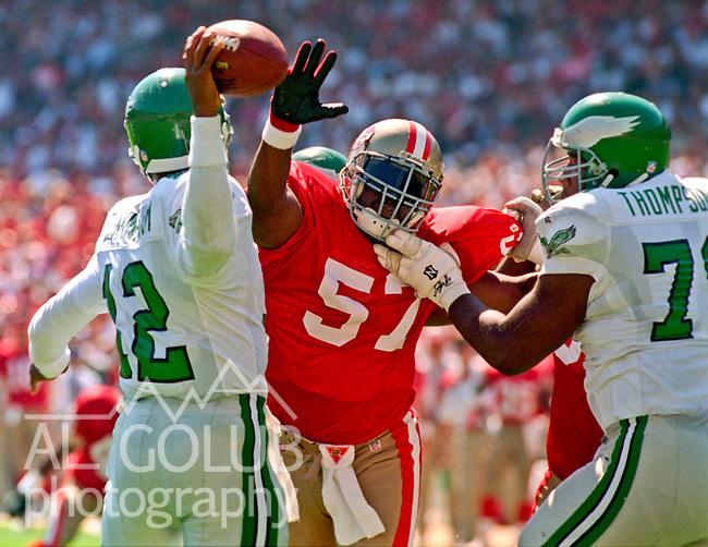 San Francisco 49ers vs. Philadelphia Eagles at Candlestick Park Sunday, October 2, 1994.  Eagles beat 49ers 40-8.  San Francisco 49ers linebacker Rickey Jackson (57) rushes Philadelphia Eagles quarterback Randall Cunningham (12).