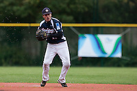 23 October 2010: Romain Scott-Martinez of Savigny throws the ball to first base during Savigny 8-7 win (in 12 innings) over Rouen, during game 3 of the French championship finals, in Rouen, France.