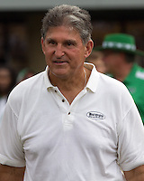 West Virginia Senator Joe Manchin. The WVU Mountaineers beat the Marshall Thundering Herd 34-13 in a game called just after the fourth quarter started because of severe thunderstorms in the area. The game was played at Milan Puskar Stadium in Morgantown, West Virginia on September 4, 2011.