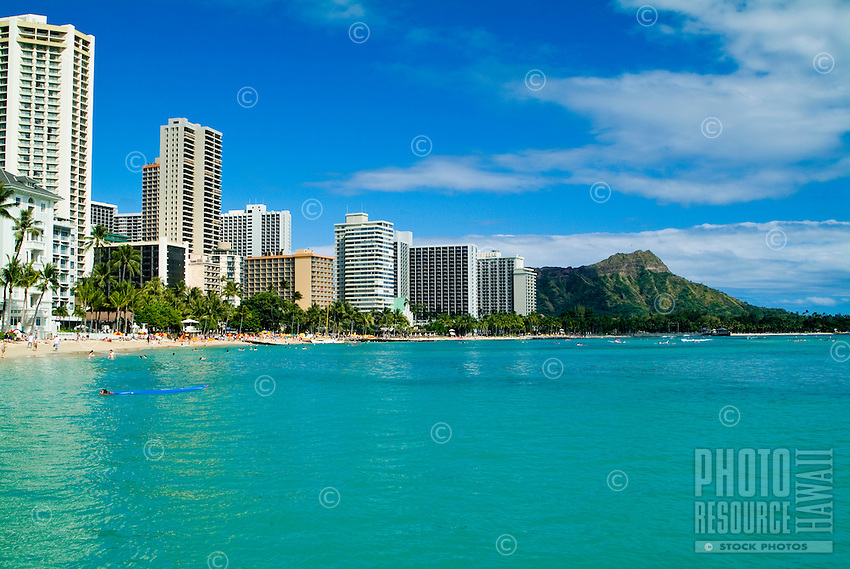 Shimmering blue water showcases the classic coastline of Waikiki and view of Diamond Head.