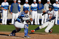 Alex Falconi #47 of the Seton Hall Pirates blocks the plate ahead of the slide by Chris Amezquita #32 of the Pepperdine Waves during a baseball game at Eddy D. Field Stadium on March 8, 2013 in Malibu, California. (Larry Goren/Four Seam Images)