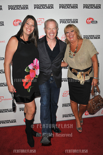 "Neal McDonough & wife & mother-in-law at the Los Angeles premiere of ""Machine Gun Preacher"" at the Academy of Motion Picture Arts & Sciences Theatre, Beverly Hills..September 21, 2011  Los Angeles, CA.Picture: Paul Smith / Featureflash"