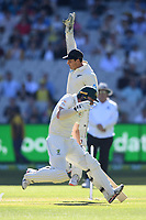 26th December 2019; Melbourne Cricket Ground, Melbourne, Victoria, Australia; International Test Cricket, Australia versus New Zealand, Test 2, Day 1; BJ Watling of New Zealand jumps for the ball as Travis Head of Australia reaches for the crease - Editorial Use