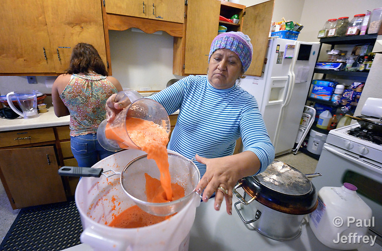 A woman who fled gang-related violence in El Salvador to seek political asylum in the United States prepares food in the kitchen of a shelter where she lives in San Antonio, Texas, on December 1, 2015. The woman, who asked not to be named, fled El Salvador after her son and daughter in law were murdered. She brought two grandchildren with her, but they were taken away by immigration officials upon arrival in the U.S. Since her release she has stayed in a shelter run by the Refugee and Immigrant Center for Education and Legal Services (RAICES) and supported by a coalition of San Antonio churches. While awaiting a decision on her request for asylum, she submitted to a DNA exam in order to prove her relation with one grandchild who remained in government care.