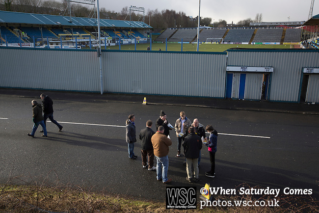 Greenock Morton 2 Stranraer 0, 21/02/2015. Cappielow Park, Greenock. Home supporters, some eating snacks, gathering outside the stadium before Greenock Morton take on Stranraer in a Scottish League One match at Cappielow Park, Greenock. The match was between the top two teams in Scotland's third tier, with Morton winning by two goals to nil. The attendance was 1,921, above average for Morton's games during the 2014-15 season so far. Photo by Colin McPherson.