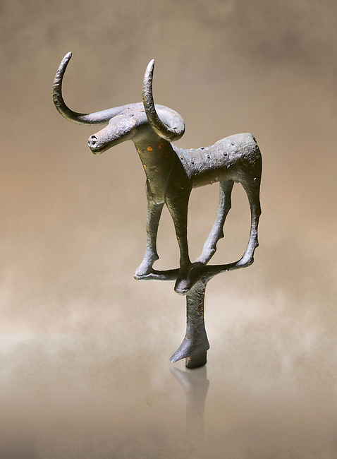 Bronze Age Hattian ceremonial bull statuette in bronze from a possible Bronze Age Royal grave (2500 BC to 2250 BC) - Alacahoyuk - Museum of Anatolian Civilisations, Ankara, Turkey. Against a warm art background