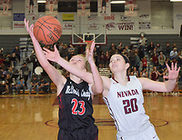 RICK PECK/SPECIAL TO MCDONALD COUNTY PRESS<br /> McDonald County's Kristin Penn battles with Nevada's Teagan Charles for a rebound during the Lady Mustangs' 58-22 loss to the Lady Tigers on Feb. 8 at Nevada High School.