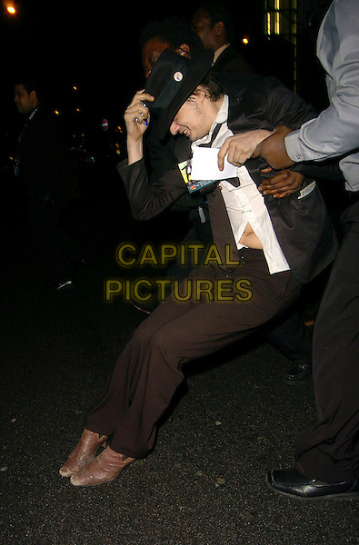 PETE DOHERTY.At the NME Awards After Show Party, .Hammersmith Palais, London, England, .February 23rd 2006..full length hat secuirty guard falling down over funny tummy.Ref: CAN.www.capitalpictures.com.sales@capitalpictures.com.©Can Nguyen/Capital Pictures