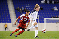 Steven Perry (11) of the Notre Dame Fighting Irish is marked by Kenney Walker (19) of the Louisville Cardinals. The Louisville Cardinals defeated the Notre Dame Fighting Irish 1-0 during the semi-finals of the Big East Men's Soccer Championship at Red Bull Arena in Harrison, NJ, on November 12, 2010.