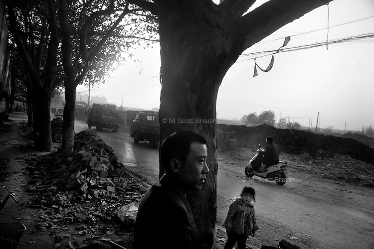 A man looks out over the demolition in what used to be a neighborhood in Nanjing, Jiangsu, China.