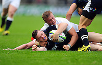 George Taylor of Scotland U20 is tackled to ground by Jack Walker of England U20. World Rugby U20 Championship match between England U20 and Scotland U20 on June 11, 2016 at the Manchester City Academy Stadium in Manchester, England. Photo by: Patrick Khachfe / Onside Images