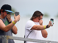 Jun 11, 2016; Englishtown, NJ, USA; NHRA fans react to the nitro methane fumes during qualifying for the Summernationals at Old Bridge Township Raceway Park. Mandatory Credit: Mark J. Rebilas-USA TODAY Sports
