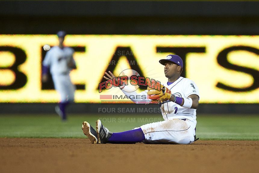 Winston-Salem Dash shortstop Winston-Salem Dash throws the ball to second base from his backside during the game against the Salem Red Sox at BB&T Ballpark on April 20, 2018 in Winston-Salem, North Carolina.  The Red Sox defeated the Dash 10-3.  (Brian Westerholt/Four Seam Images)
