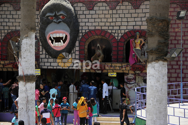 Egyptians enjoy playing games at Japanese park, in Cairo July 18, 2015, on the second day of Eid al-Fitr holiday which marks the end of the Muslim holy month of Ramadan. Photo by Amr Sayed