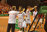 14-sept.-2013,Netherlands, Groningen,  Martini Plaza, Tennis, DavisCup Netherlands-Austria, Doubles,   Dutch team winning doubles, Captain Jan Siemerink embracing Jean-Julien Rojer, Robin Haase shakes umpire's hand<br /> Photo: Henk Koster