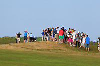 The crowd protect themselves from a wayward ball from the 18th tee during Round 4 of the East of Ireland Amateur Open Championship sponsored by City North Hotel at Co. Louth Golf club in Baltray on Monday 6th June 2016.<br /> Photo by: Golffile   Thos Caffrey