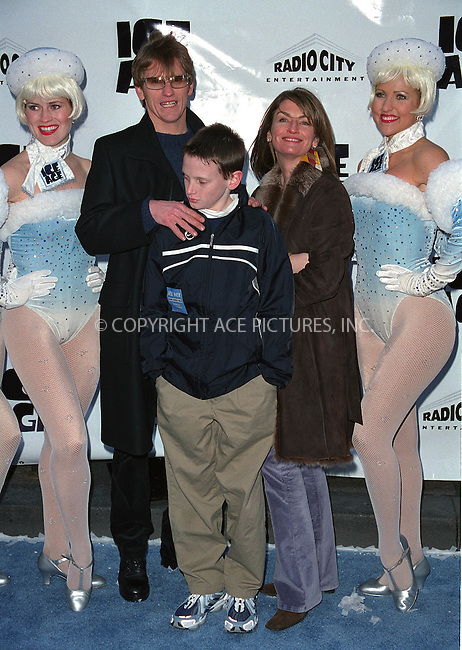 """Actor and comedian DENIS LEARY with his wife ANN LEMBECK and their son attend the world premiere of """"Ice Age"""" at the Radio City Music Hall in New York. March 10, 2002. © 2002 by Alecsey Boldeskul/NY Photo Press.   ..*PAY-PER-USE*      ....NY Photo Press:  ..phone (646) 267-6913;   ..e-mail: info@nyphotopress.com"""