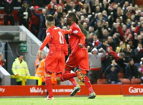 25.10.2015. Anfield, Liverpool, England. Barclays Premier League. Liverpool versus Southampton. Liverpool striker Roberto Firmino congratulates Liverpool striker Christian Benteke after Benteke's headed goal.