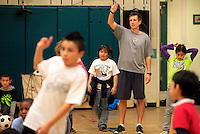 11162011 - Women's Soccer assistant coach Rich Schreiner volunteers with students at Bailey Gatzert elementary school as part of the Youth Initiative.