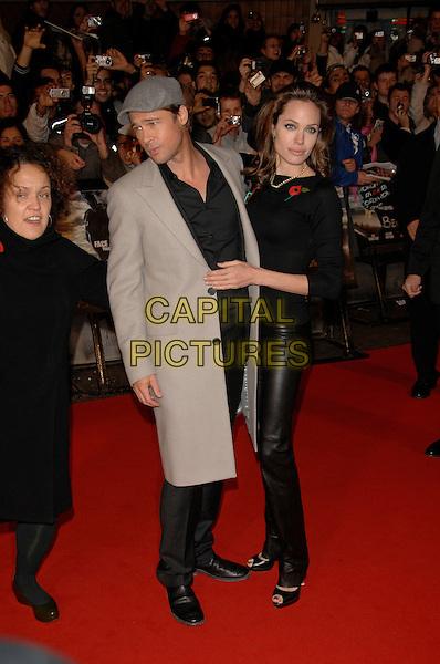 "BRAD PITT & ANGELINA JOLIE.""Beowulf"" European film premiere.Vue cinema, Leicester Square, London, England.11th November 2007.full length black leather trousers grey hat cap coat couple .CAP/PL.©Phil Loftus/Capital Pictures"