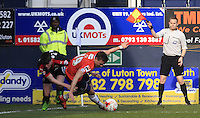The linesman signals for a freekick after Olly Lee of Luton Town in eventually brought to the ground during the Sky Bet League 2 match between Luton Town and Crawley Town at Kenilworth Road, Luton, England on 12 March 2016. Photo by Liam Smith.