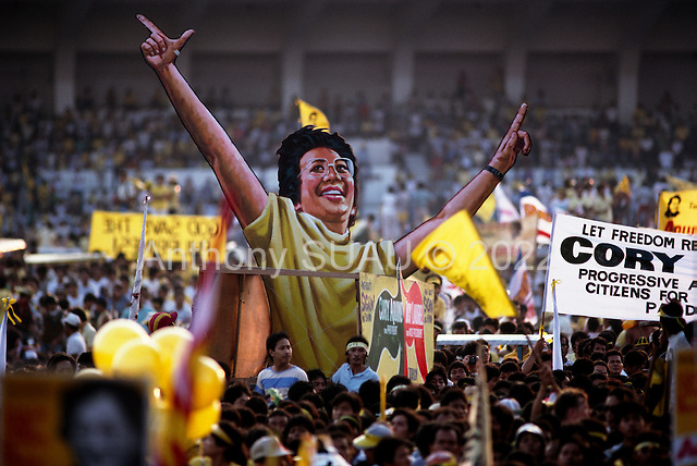 Manila, Philippines<br /> February 1986<br /> <br /> Corazon Aquino campaigning for President of the Philippines in 1986.<br /> <br /> Corazon Aquino was born into one of the wealthiest families in the Philippines, Mrs. Aquino began her political education by playing the dutiful wife as the political career of her husband, Benigno Aquino Jr., expanded. In less than 20 years he emerged as one of the chief potential rivals of Mr. Marcos, who was then president. When Mr. Marcos declared martial law in 1972, her husband was arrested and imprisoned for seven years. He was assassinated in 1983 after returning to the Philippines from a three-year exile in the United States. Mr. Marcos was widely blamed for the murder. It was at Mr. Aquino's funeral that Mrs. Aquino, became a national symbol, demonstrating the dignity and composure that would characterize her most difficult moments as president. <br /> <br /> Mrs. Aquino came to power through what amounted to popular acclaim -- what the Philippino people called &quot;people power&quot; -- expressed by huge crowds that gathered in support of her. Her popularity reached its peak during her presidential campaign against Mr. Marcos in January 1986, when she was surrounded by enthusiastic crowds chanting, &quot;Cory! Cory! Cory!'&quot;<br /> <br /> Her act of knocking down a dictator and bringing democracy to the Philippines was a high point in the country's modern history, and it offered a model for nonviolent uprisings that has been repeated often in other countries...Mrs. Aquino, was often criticized as an indecisive and ineffectual leader. But she combined passivity and stubbornness and an unexpected shrewdness to hold firm against powerful opponents from both the right and the left, and one of her greatest accomplishments as president was fending off a half dozen coup attempts. <br /> <br /> The restoration of democracy, and the transition to a new president, were Mrs. Aquino's prime legacies. Yet she led demonstrations aga