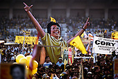"Manila, Philippines<br /> February 1986<br /> <br /> Corazon Aquino campaigning for President of the Philippines in 1986.<br /> <br /> Corazon Aquino was born into one of the wealthiest families in the Philippines, Mrs. Aquino began her political education by playing the dutiful wife as the political career of her husband, Benigno Aquino Jr., expanded. In less than 20 years he emerged as one of the chief potential rivals of Mr. Marcos, who was then president. When Mr. Marcos declared martial law in 1972, her husband was arrested and imprisoned for seven years. He was assassinated in 1983 after returning to the Philippines from a three-year exile in the United States. Mr. Marcos was widely blamed for the murder. It was at Mr. Aquino's funeral that Mrs. Aquino, became a national symbol, demonstrating the dignity and composure that would characterize her most difficult moments as president. <br /> <br /> Mrs. Aquino came to power through what amounted to popular acclaim -- what the Philippino people called ""people power"" -- expressed by huge crowds that gathered in support of her. Her popularity reached its peak during her presidential campaign against Mr. Marcos in January 1986, when she was surrounded by enthusiastic crowds chanting, ""Cory! Cory! Cory!'""<br /> <br /> Her act of knocking down a dictator and bringing democracy to the Philippines was a high point in the country's modern history, and it offered a model for nonviolent uprisings that has been repeated often in other countries...Mrs. Aquino, was often criticized as an indecisive and ineffectual leader. But she combined passivity and stubbornness and an unexpected shrewdness to hold firm against powerful opponents from both the right and the left, and one of her greatest accomplishments as president was fending off a half dozen coup attempts. <br /> <br /> The restoration of democracy, and the transition to a new president, were Mrs. Aquino's prime legacies. Yet she led demonstrations against all 3 of her successors.<br /> <br /> She died on July 31, 2009."
