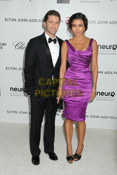 Matthew Morrison & Renee Puente.20th Annual Elton John Academy Awards Viewing Party held at West Hollywood Park, West Hollywood, California, USA..February 26th, 2012.full length tuxedo purple dress couple black white bow tie.CAP/ADM/BP.©Byron Purvis/AdMedia/Capital Pictures.