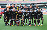 DC United posing for a team photo with Owner Will Chang.  DC United defeated El Salvador National Team 1-0 in a international charity match at RFK Stadium, Saturday June 19, 2010.