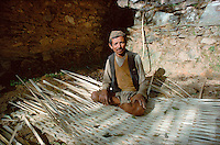.Tamang (tribal) villager making wattle shelter, Everest trail, Nepal...
