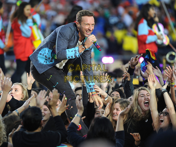 SAN FRANCISCO, CA - FEBRUARY 7: Chris Martin of Coldplay performs during the Pepsi Halftime show at Super Bowl 50 at Levi's Stadium on February 7, 2016 in Santa Clara, California.<br /> CAP/MPIFM<br /> &copy;MPIFM/Capital Pictures