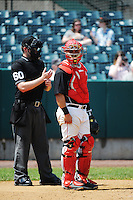 New Britain Rock Cats catcher  Josmil Pinto (36) has a talk with home plate umpire John Bacon (60) during game against the Richmond Flying Squirrels at New Britain Stadium on May 30, 2013 in New Britain, CT.  New Britain defeated Richmond 2-1.  (Tomasso DeRosa/Four Seam Images)
