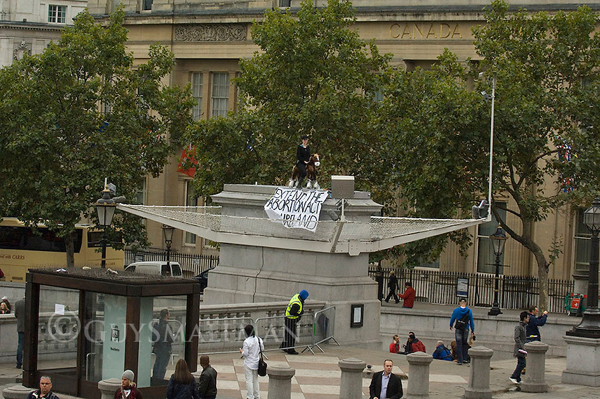 Comedian Kate Smurthwaite occupies the 4th plinth in Trafalgat square to demand that the 1967 Abortion Act is extended to Northern Ireland. She was taking the place of Belfast pro choice campaigner Goretti Horgan.