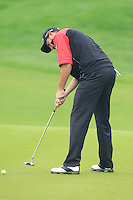David Howell (ENG) putts on the 3rd green during Thursday's Round 1 of the 2014 BMW Masters held at Lake Malaren, Shanghai, China 30th October 2014.<br /> Picture: Eoin Clarke www.golffile.ie